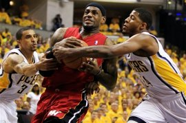 Last May, Paul George and George Hill made life difficult for LeBron James.  Paul George's defensive instincts and his length will give LeBron fits again this spring.  (AP Photo)