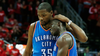 Kevin Durant embraces Thunder teammate Reggie Jackson during Game 4.