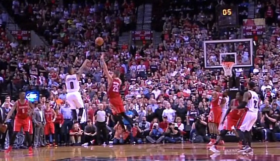 Damian Lillard rises and releases the ball as time expires, over the out-stretched arm of Chandler Parsons.